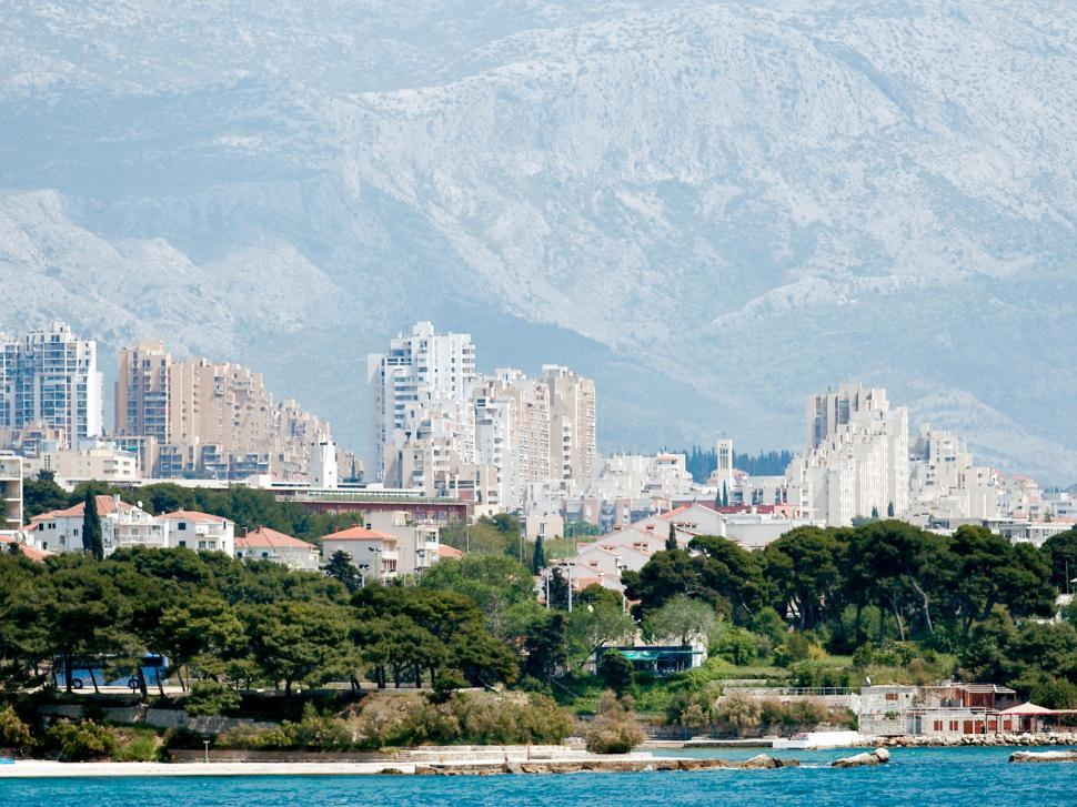 Download Free Stock HD Photo of Ugly city, beautiful coast Online