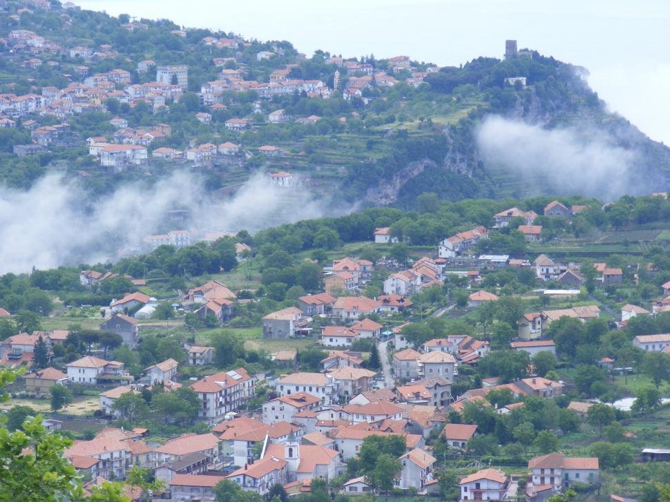 Download Free Stock HD Photo of Small rural mountain town under the clouds  Online