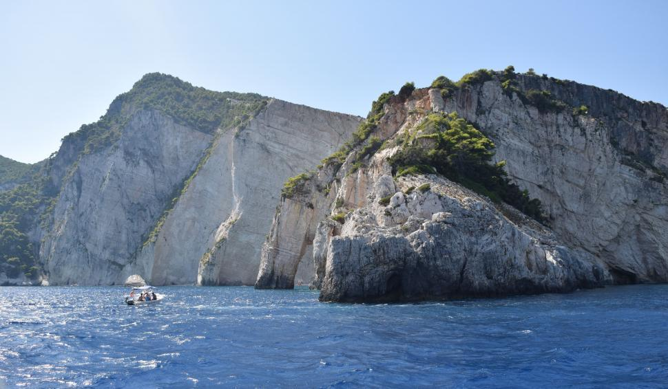 Download Free Stock HD Photo of Rocky shoreline with boats, Mediterranean Sea in Greece  Online