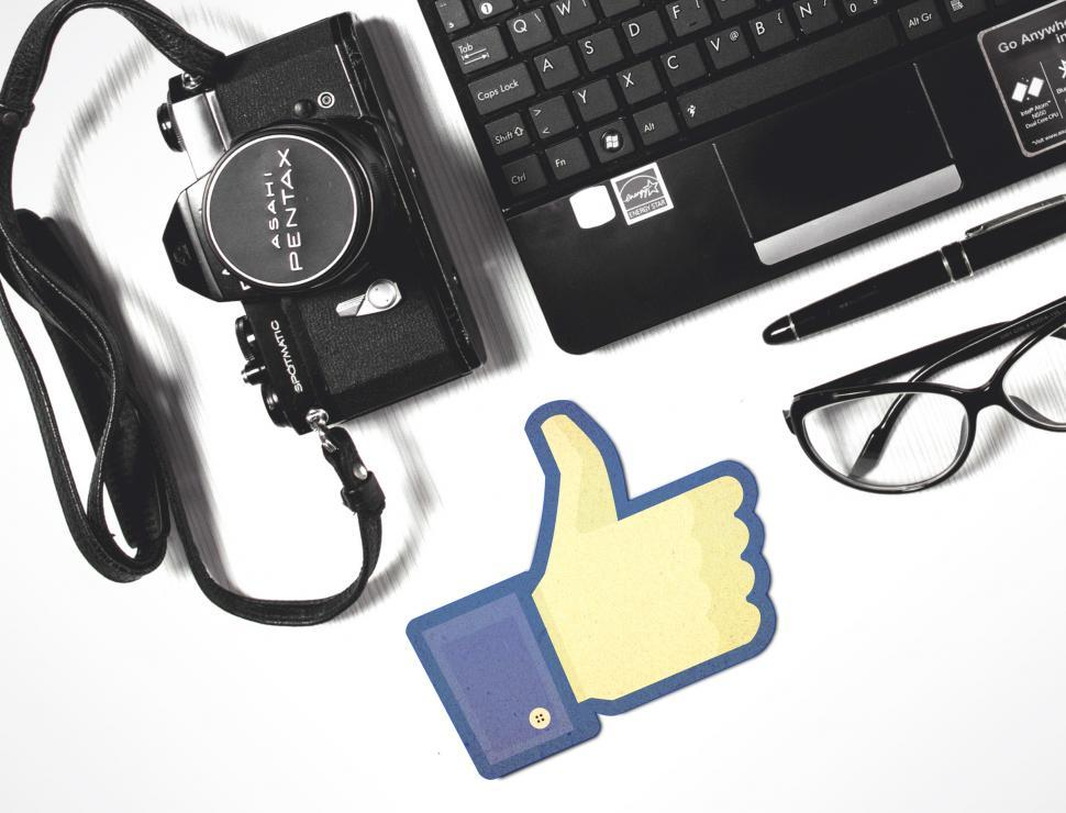Download Free Stock HD Photo of Facebook Thumbs-Up with Laptop and Camera Online