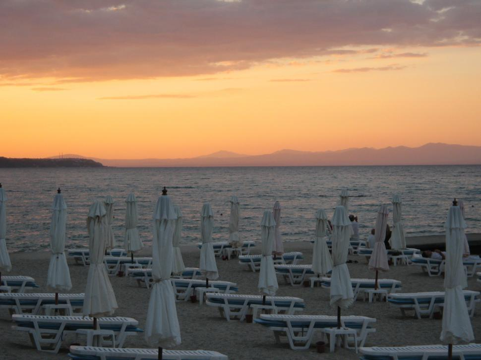 Download Free Stock HD Photo of Sunset at the beach in Greece Online