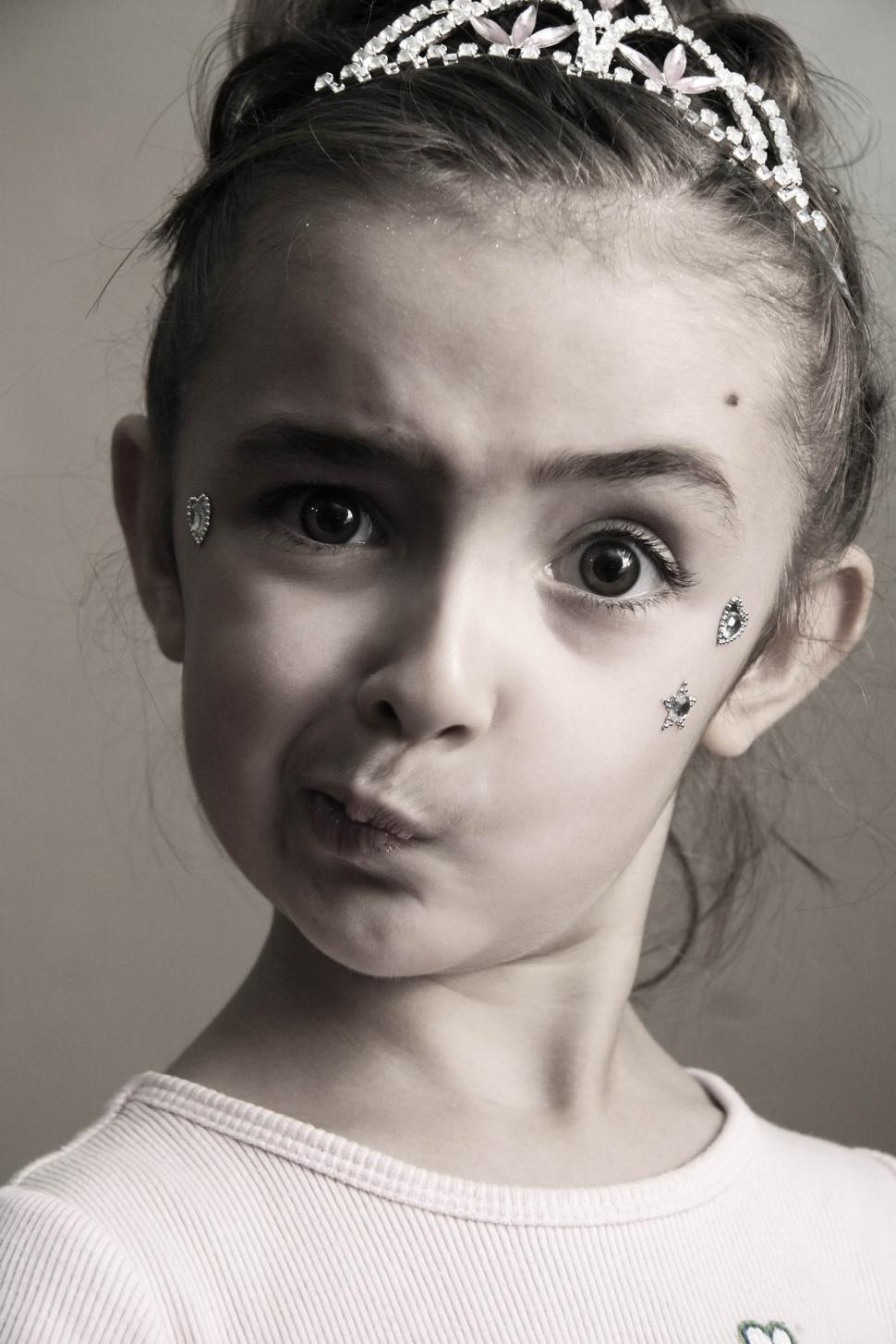 Download Free Stock HD Photo of Puzzled little girl princess Online