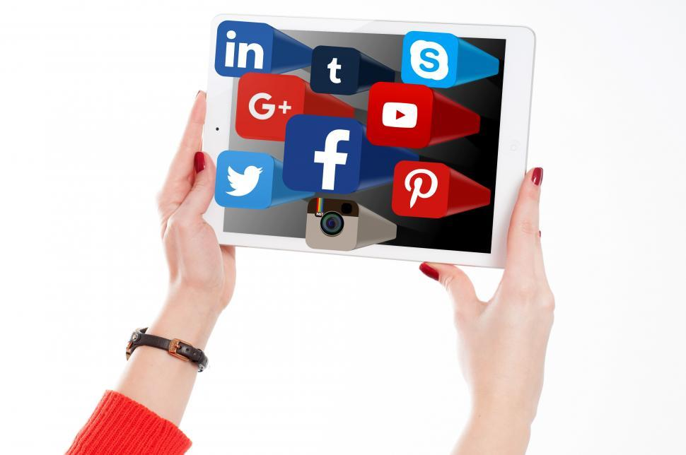 Download Free Stock HD Photo of Woman Holding Tablet with Social Media Networks Logos Online