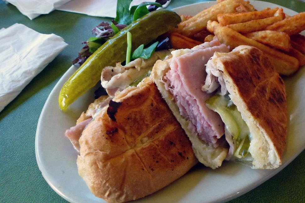 Download Free Stock HD Photo of Cuban Sandwich with Fries, Pickles and Greens Online