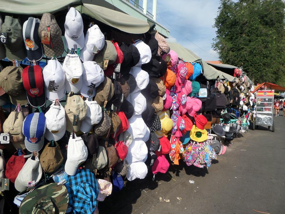 Download Free Stock HD Photo of Hats on display at street  clothing market  Online