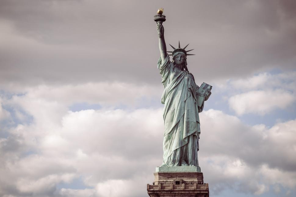 Download Free Stock HD Photo of Statue of Liberty stands with torch Online