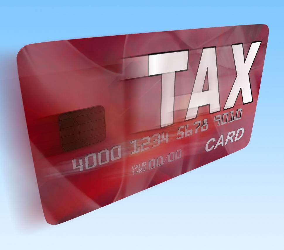 Download Free Stock HD Photo of Tax On Credit Debit Card Flying Shows Taxes Return IRS Online