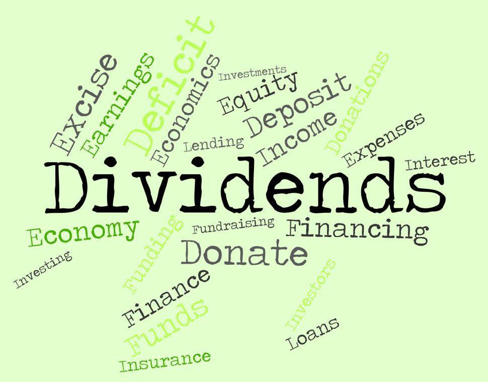 Download Free Stock HD Photo of Dividends Word Shows Stock Market And Revenues Online