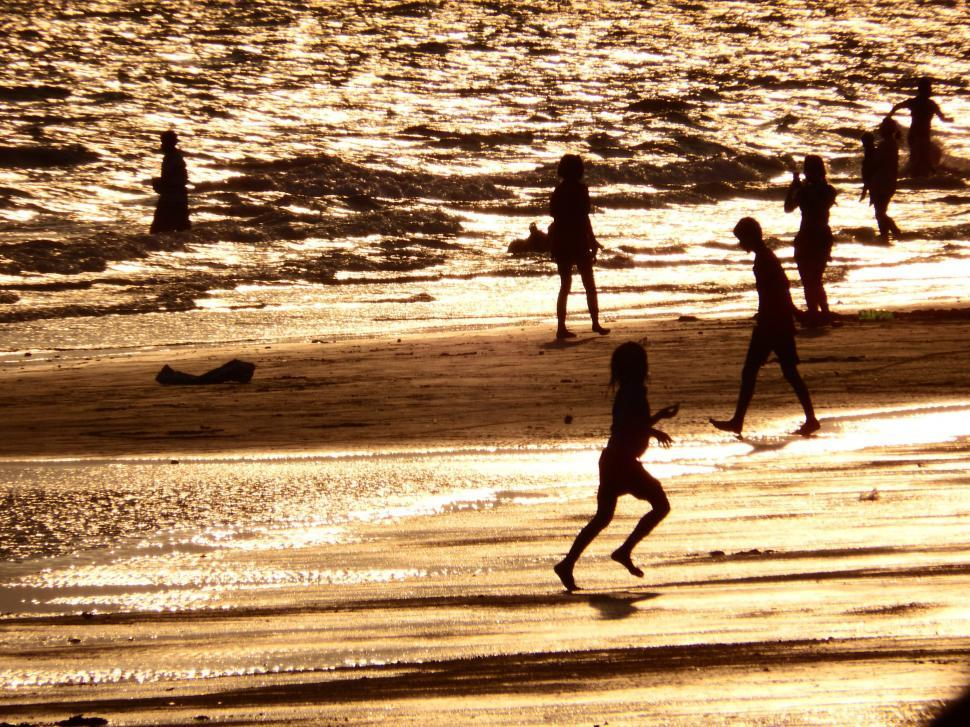 Download Free Stock HD Photo of Family Plays on the Beach Silhouette  Online