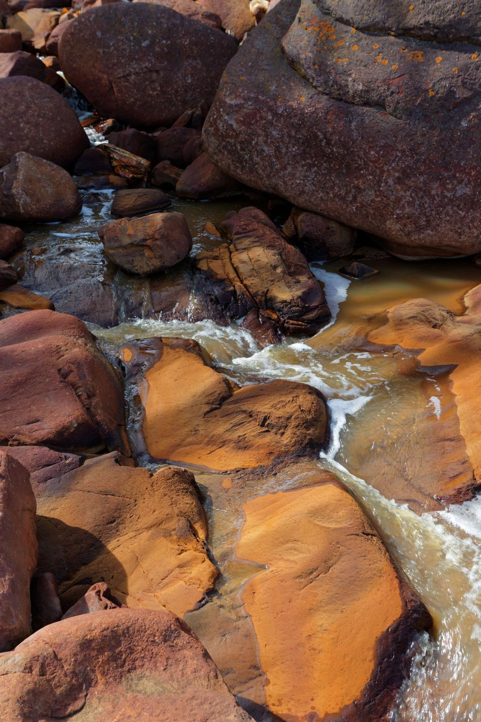 Download Free Stock HD Photo of Iron leachate on rocks Online