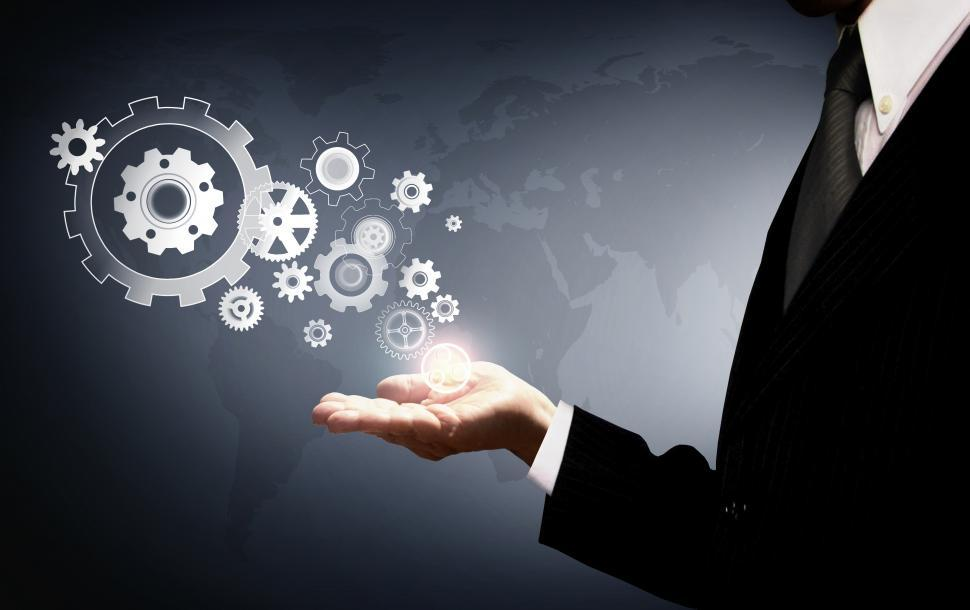 Download Free Stock HD Photo of Businessman Holding Virtual Cogwheels - Business and Work Online