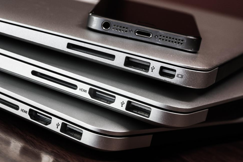 Download Free Stock HD Photo of Three laptops and a phone Online