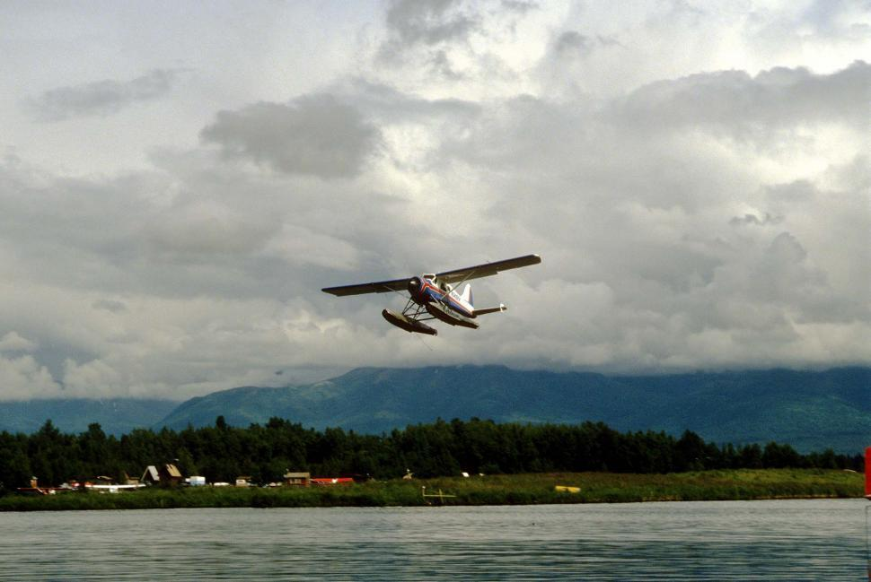 Download Free Stock HD Photo of seaplane landing 2 Online