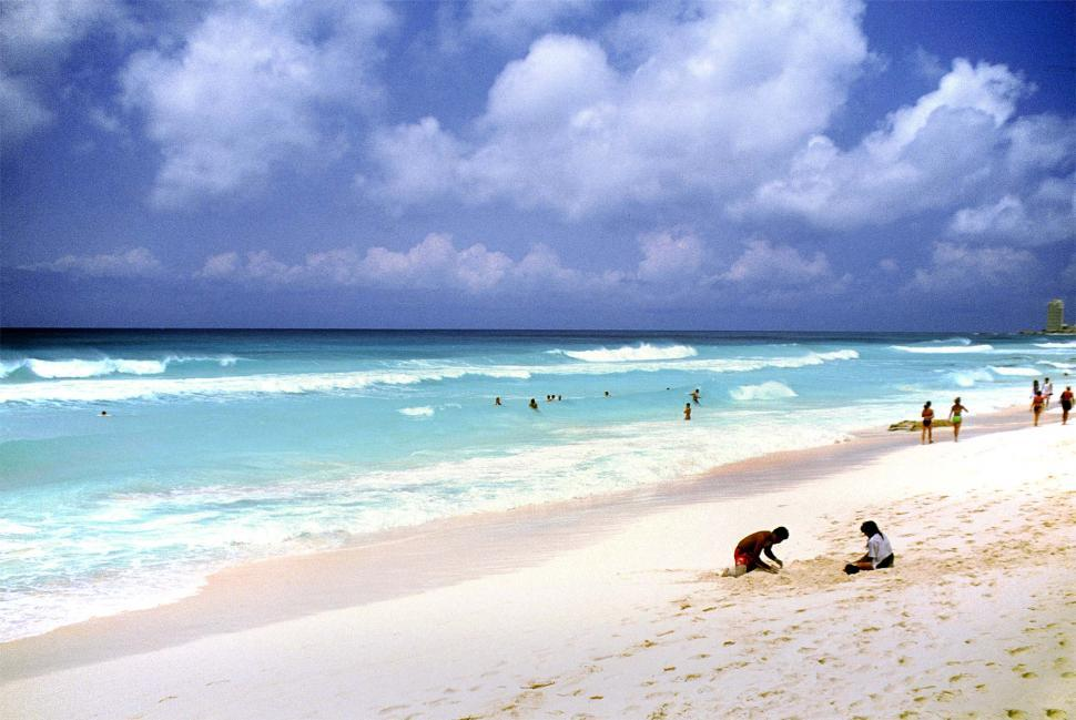 Free image of people on the beach, enjoying vacations