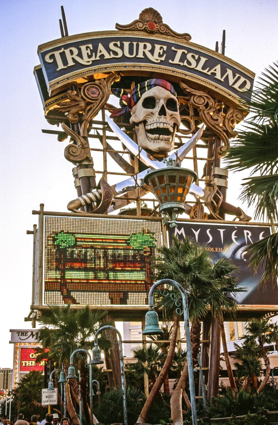 Download Free Stock HD Photo of Pirate-themed sign at Treasure Island Hotel Online