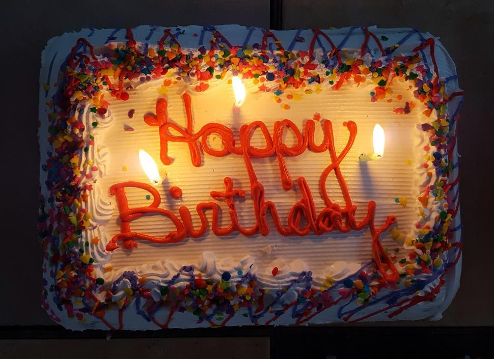 Free image of An ice cream birthday cake with  Happy Birthday  written on the top of the cake.