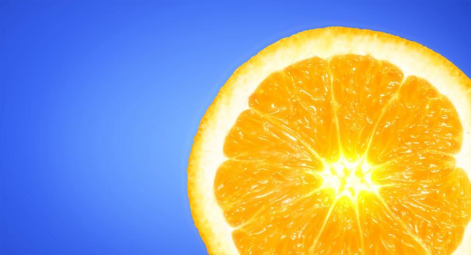 Download Free Stock HD Photo of Orange Slice on Sky Blue Background - Vivid Colors with Copyspac Online