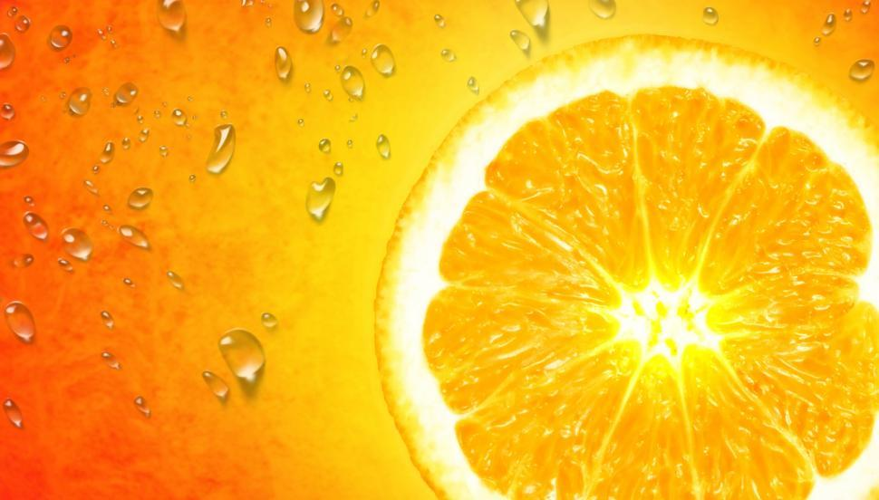 Orange Slice on Orange Background - Vivid Colors with Copyspace