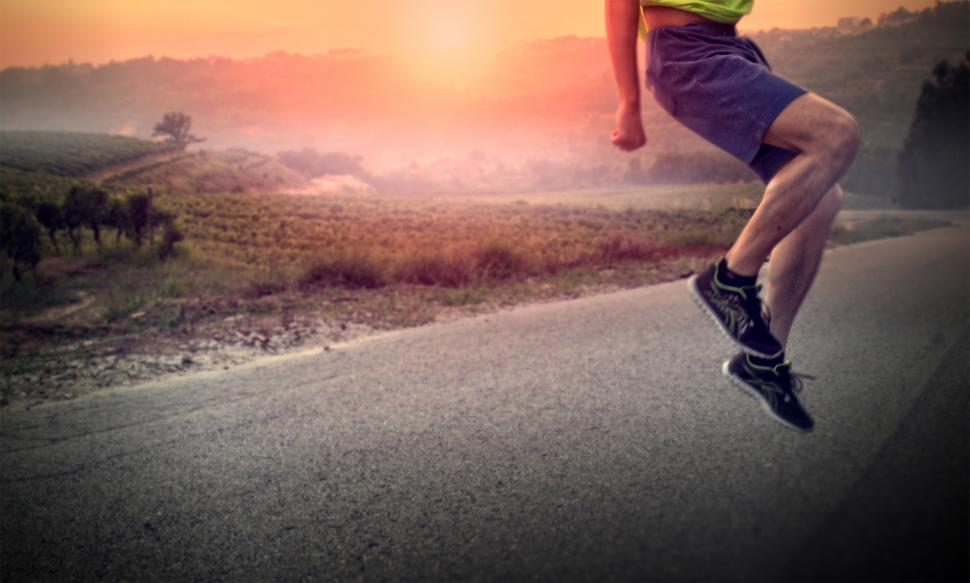 Download Free Stock HD Photo of Warming Up - Male Athlete Performing Squat Jumps at Sunrise Online