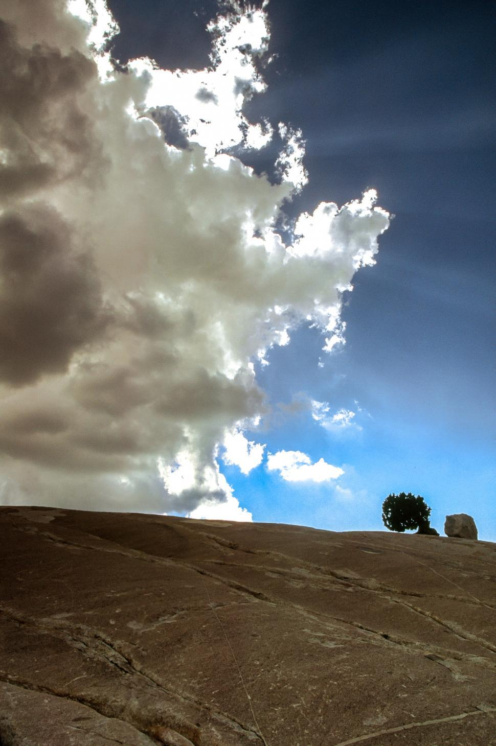 Download Free Stock HD Photo of Cloudscape over rocks Online