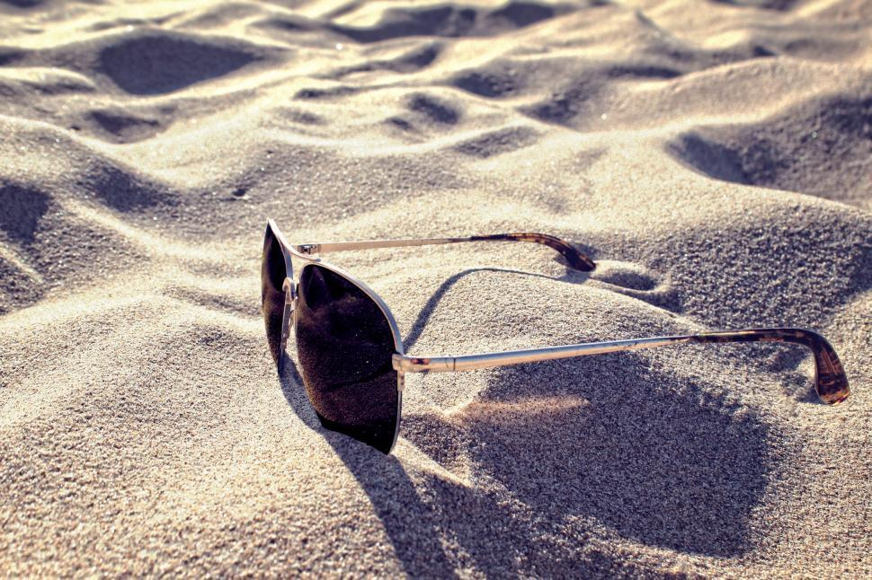 Download Free Stock HD Photo of Sunglasses on the Sand - Summer Concept Online
