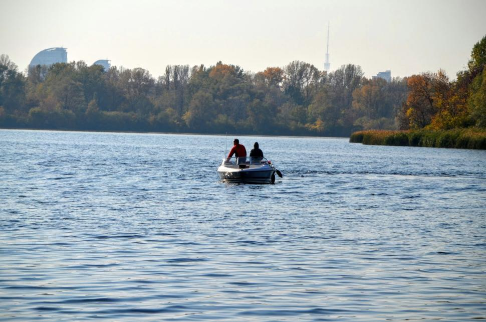 Download Free Stock HD Photo of Two fishermen on a boat in the middle of the river  Online