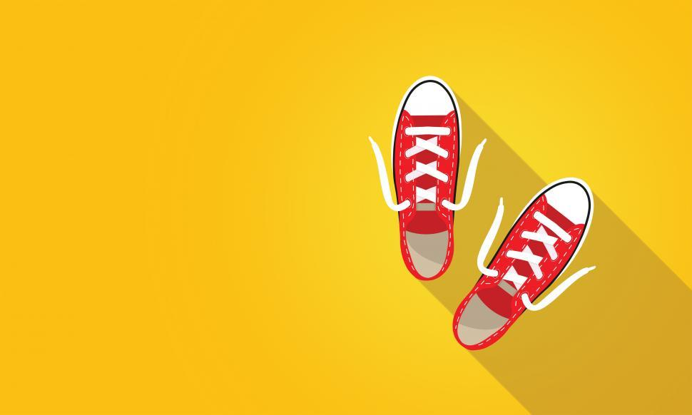 Download Free Stock HD Photo of Red Sneakers on Bright Yellow Background - With Copyspace Online