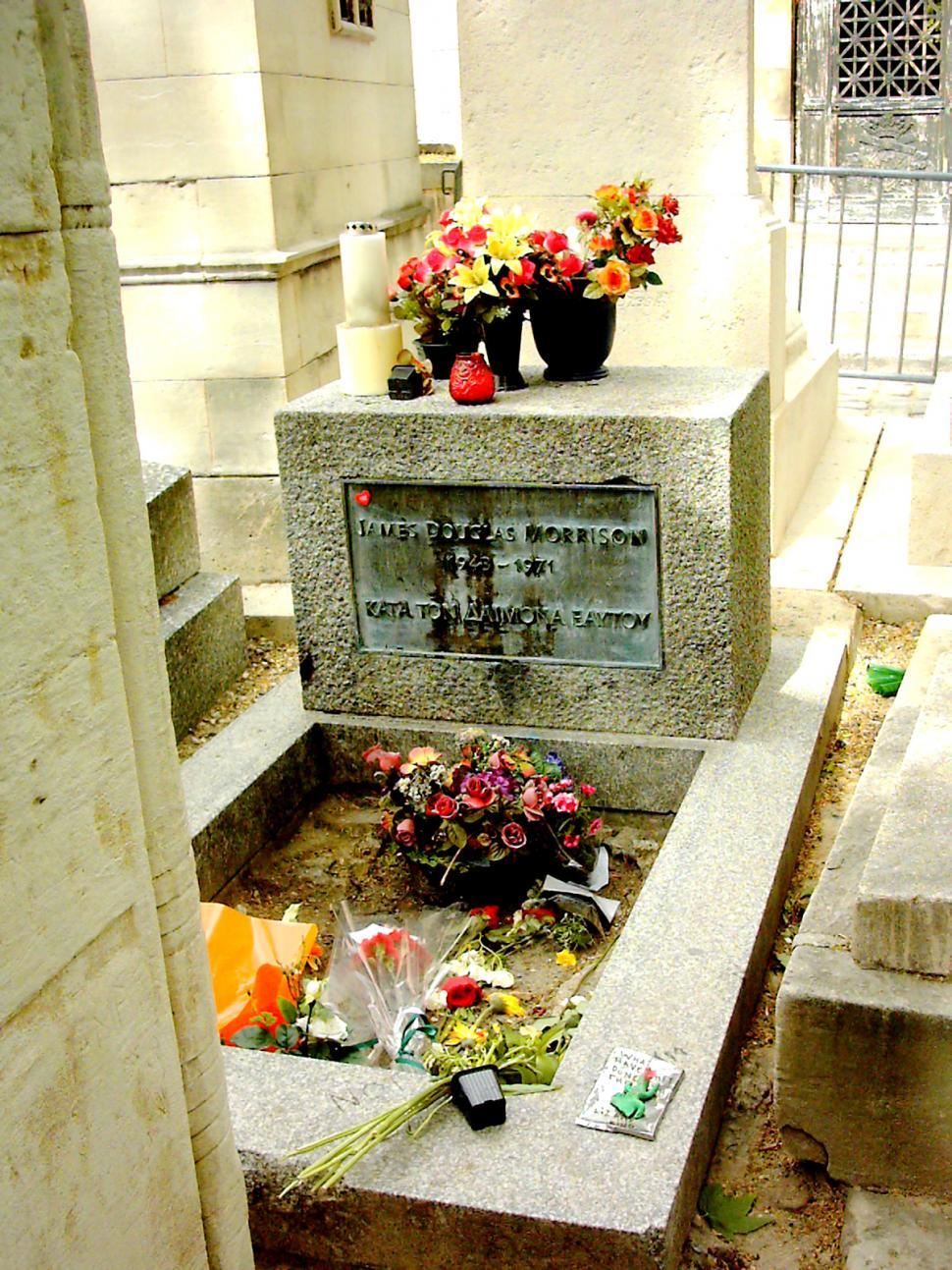 Free image of Jim Morrison's grave at Pere Lachaise in Paris