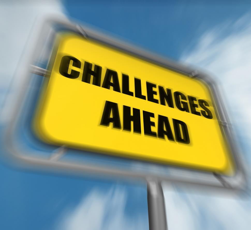 Download Free Stock HD Photo of Challenges Ahead Sign Displays to Overcome a Challenge or Diffic Online