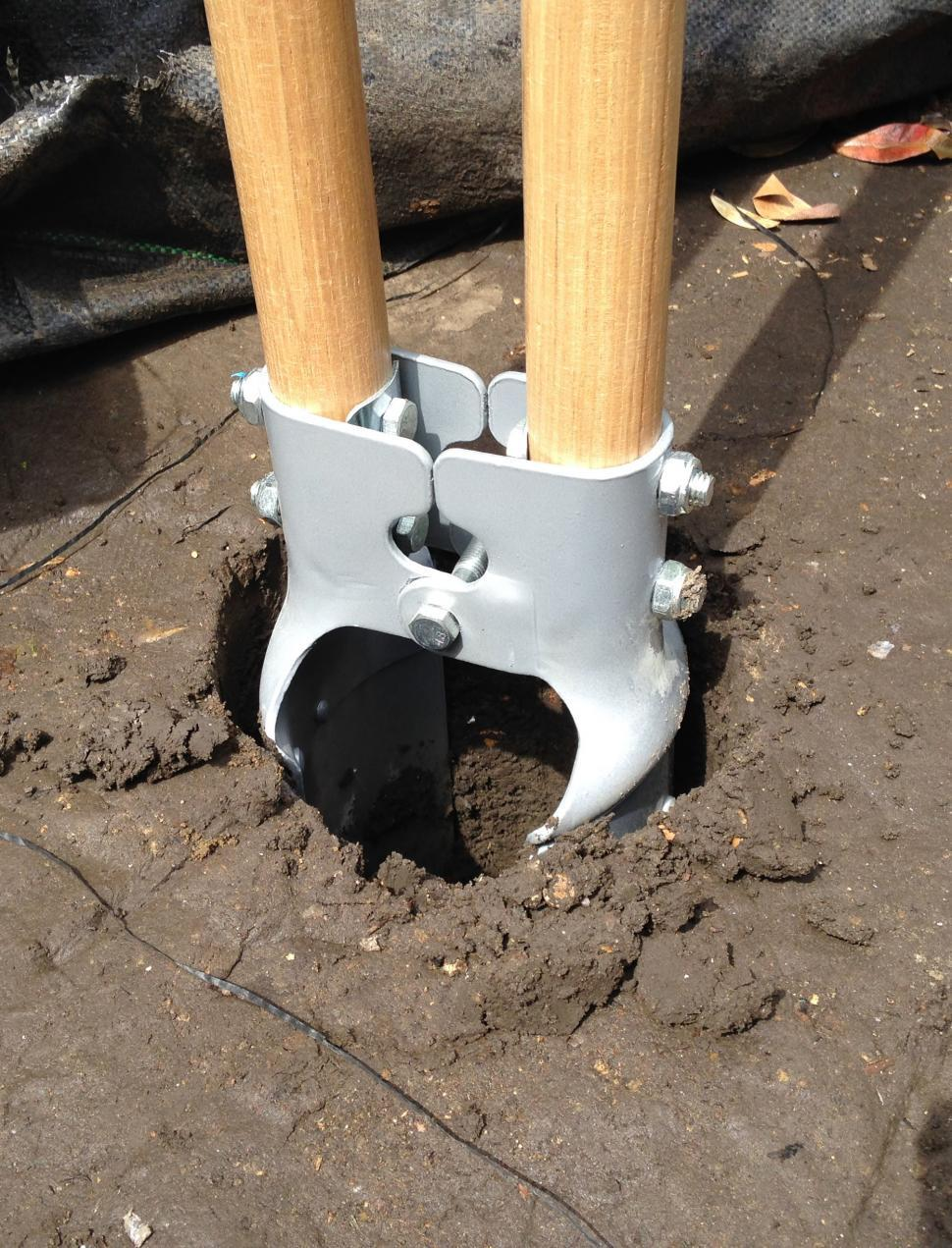 Download Free Stock HD Photo of Post hole digger in hole Online