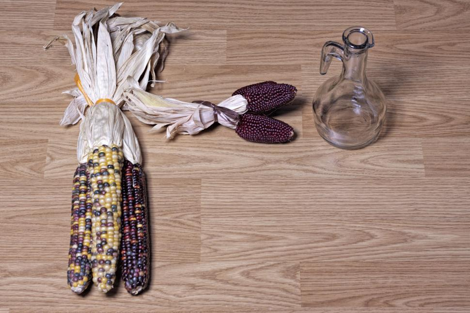 Download Free Stock HD Photo of Corn and oil bottle Online
