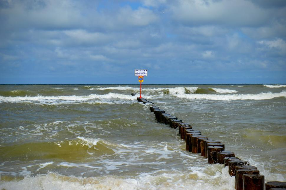 Download Free Stock HD Photo of Breakwaters with a wooden deck in a stormy sea. Baltic Sea  Online