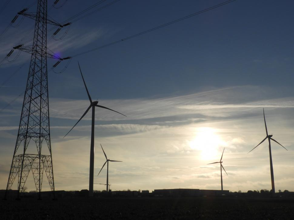 Download Free Stock HD Photo of Four wind turbines and a power line mast  Online