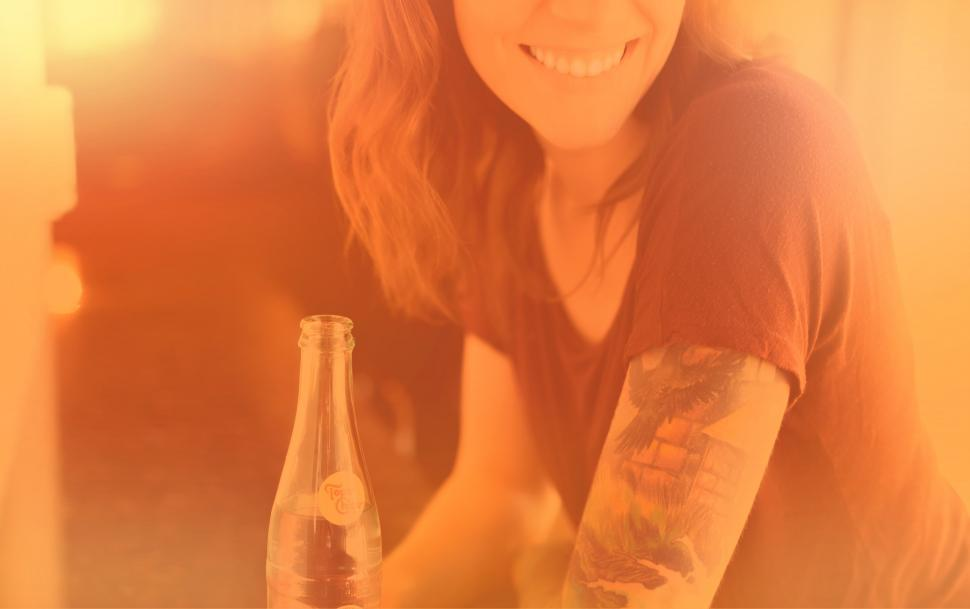 Download Free Stock HD Photo of Woman with Drink Smiling - Colorized Hazy Effect Online