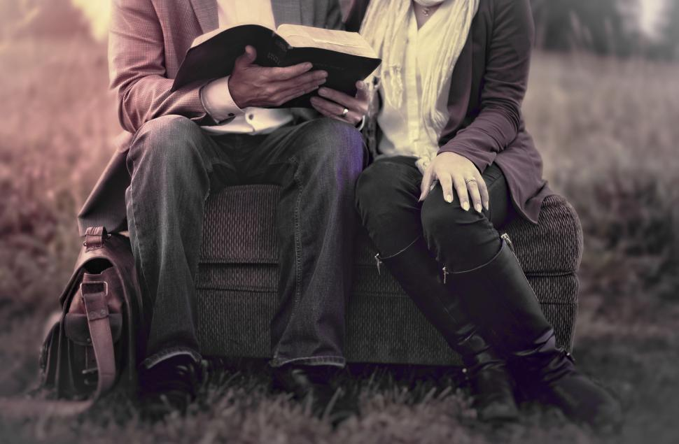 Download Free Stock HD Photo of Couple in Love Reading Outdoors - Washed-out Effect Online