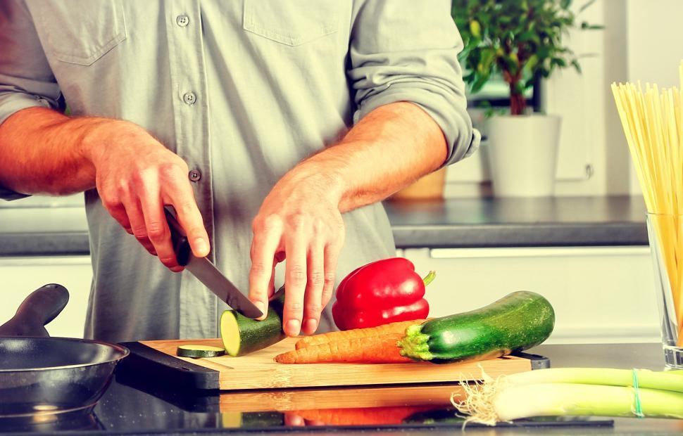 Download Free Stock HD Photo of Cooking - A Man Chopping Veggies Online
