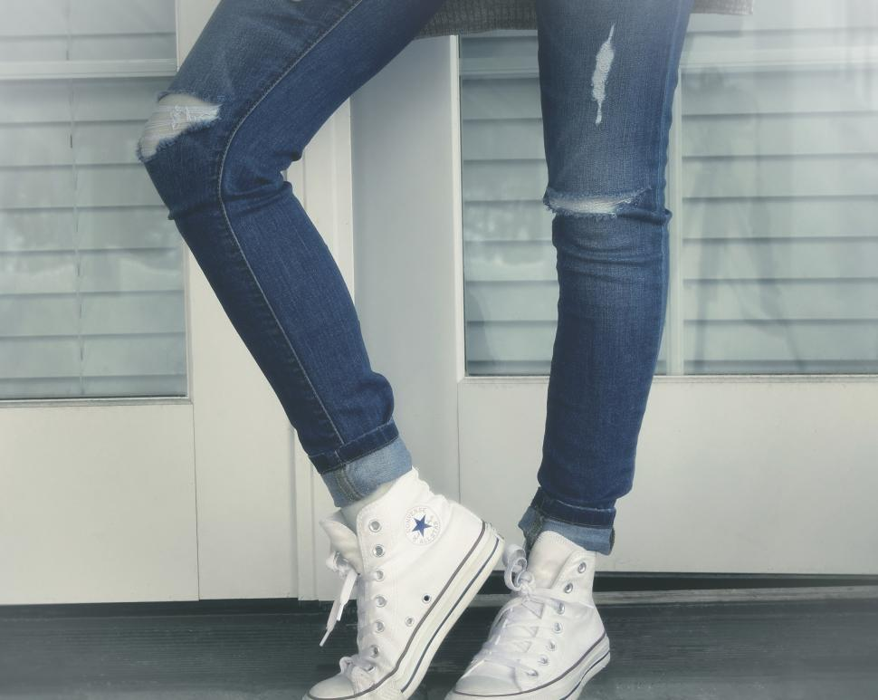 Download Free Stock HD Photo of Urban Girl - Close-Up of Legs - Ripped Jeans and Sneakers Online