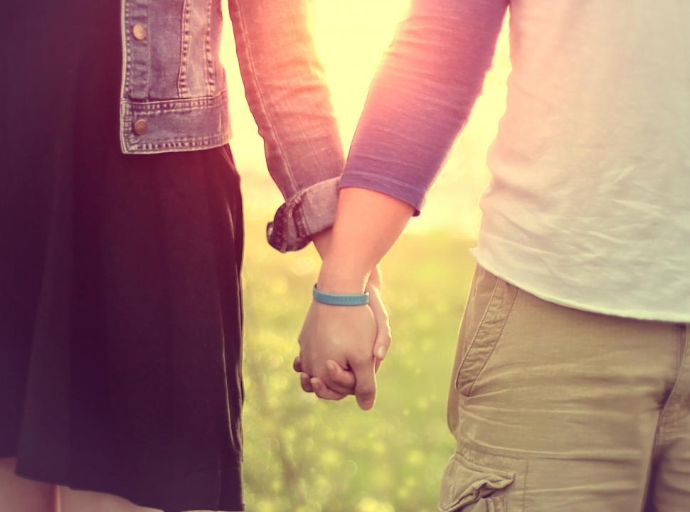 Download Free Stock HD Photo of Couple Walking Hand in Hand Online