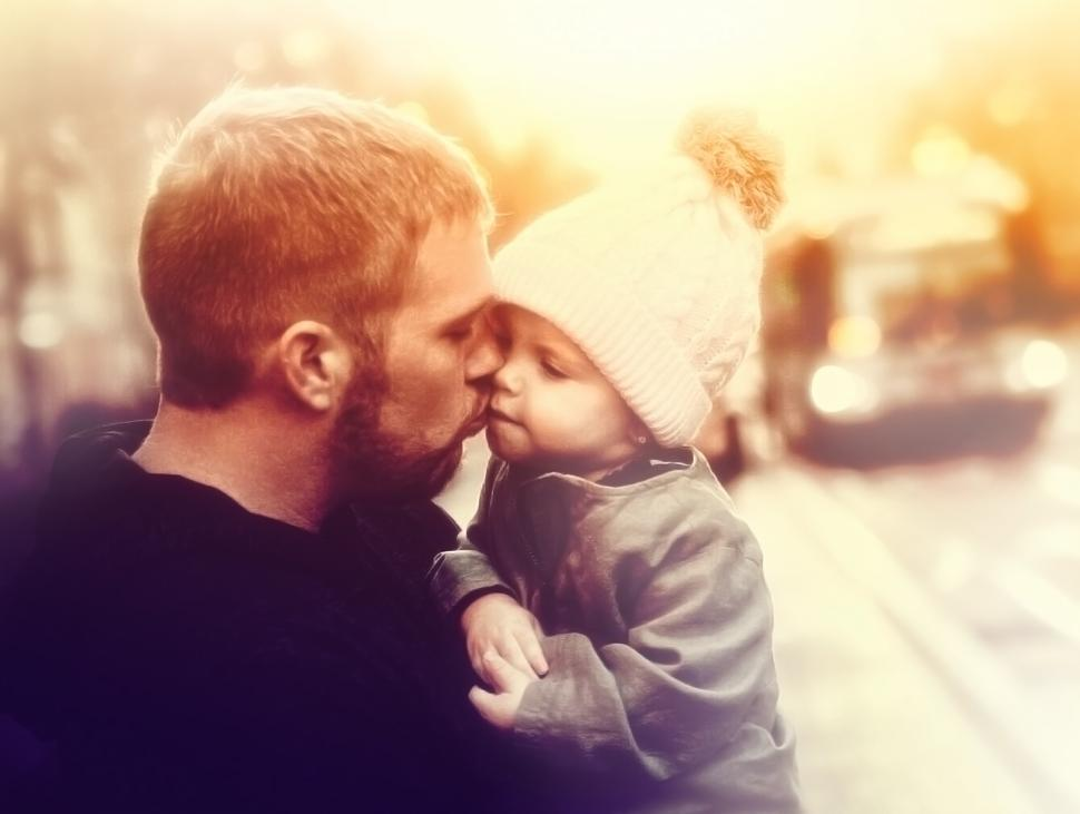 Download Free Stock HD Photo of Loving Father Kissing Baby Girl - Colorized Online