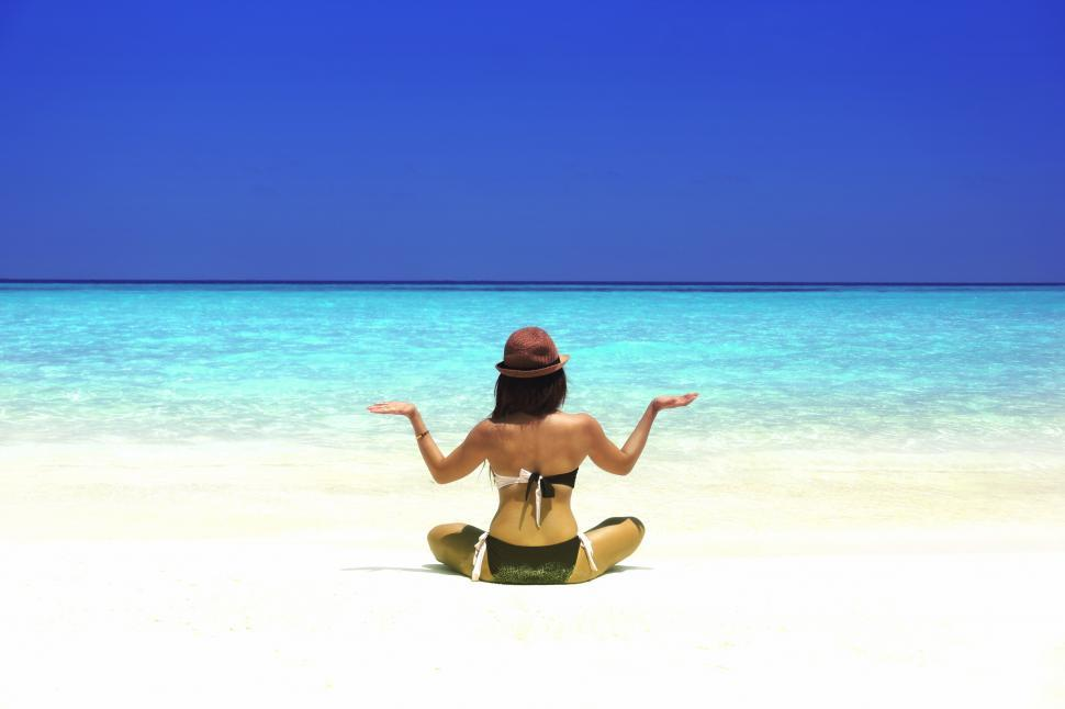Download Free Stock HD Photo of Woman Practicing Yoga on the Beach - Vivid Colors Online