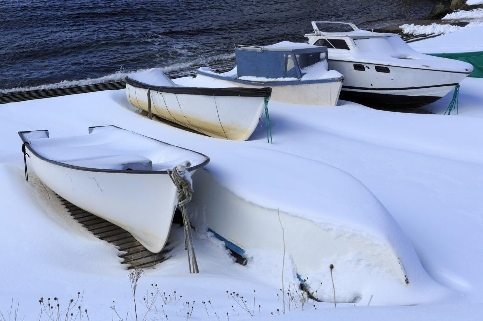 Download Free Stock HD Photo of Snow covered fishing boats on slipway Online
