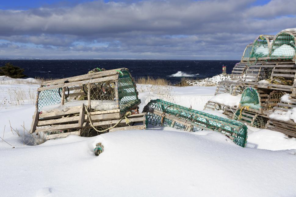Download Free Stock HD Photo of Snow covered lobster traps near ocean Online