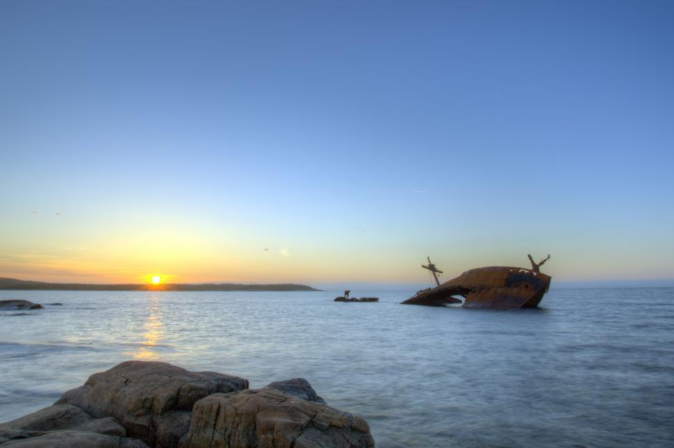 Download Free Stock HD Photo of Shipwreck with rocks and sunset Online