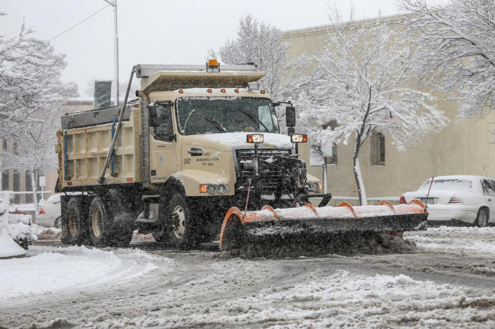 Free image of Plowing city streets after and during a snow storm.