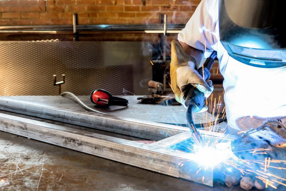 Download Free Stock HD Photo of Welding a metal truss Online