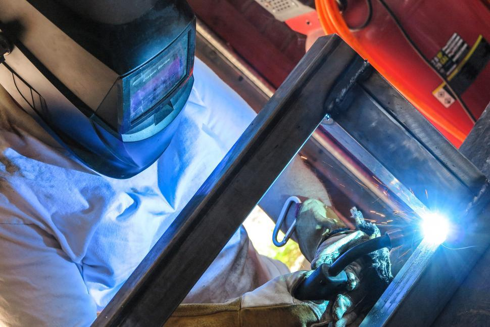 Download Free Stock HD Photo of Weld glows hot Online