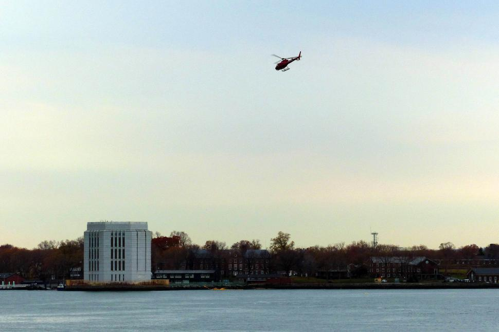 Download Free Stock HD Photo of Helicopter Over Governors Island Online