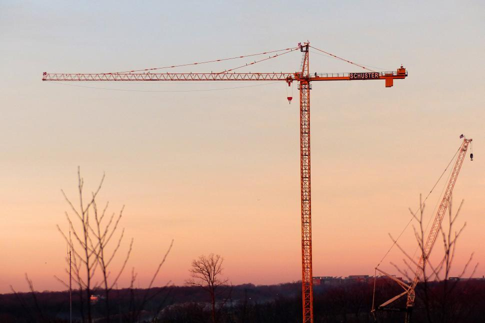 Download Free Stock HD Photo of Construction Crane At Dawn Online