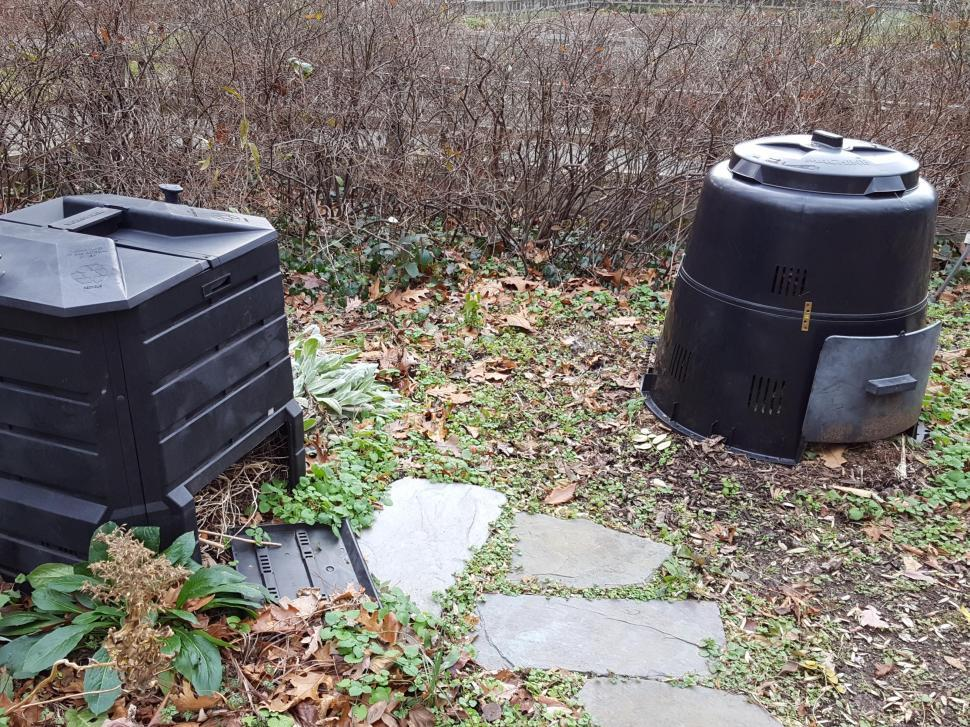 free image of two black plastic compost bins in a garden