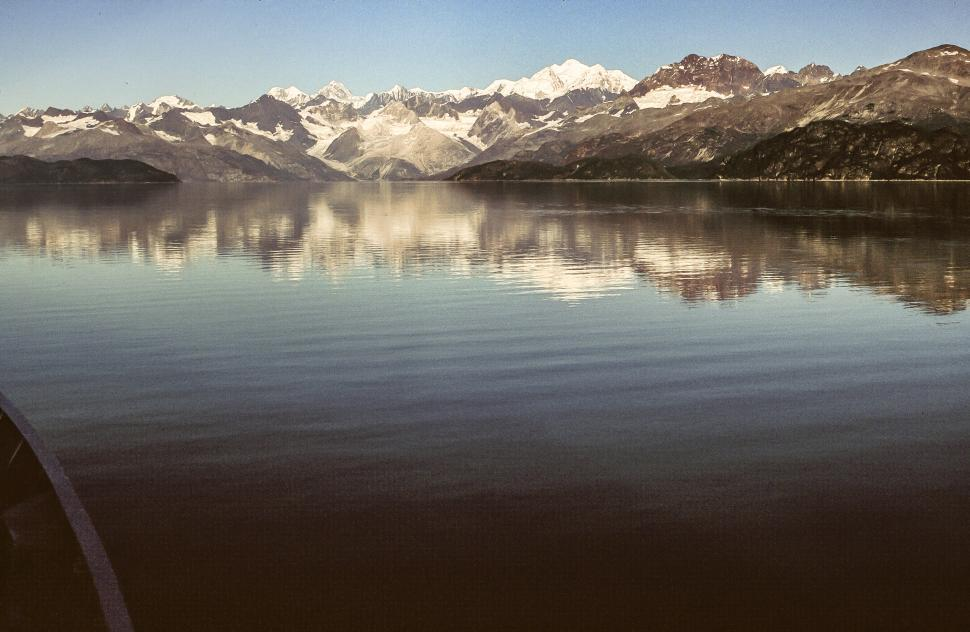 Free image of View of lake as snow capped mountains seen in the background